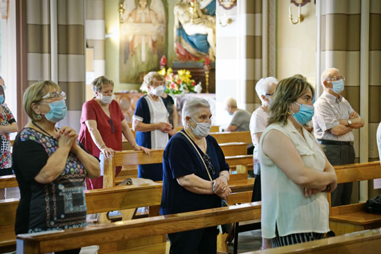 Church with masks on COVID 550 Shutterstock