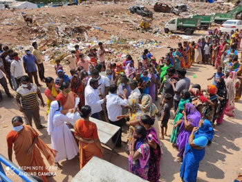 Distribution of groceries to slum dwellers in India 350