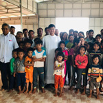 Fr Long Nguyen SVD with parishioners in Vietnam 150