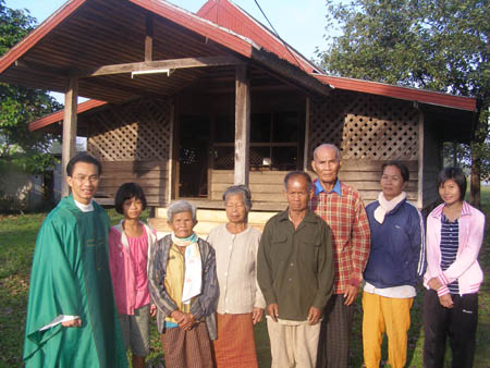 Fr Truc Quoc Phan SVD with parishioners in Thailand 450