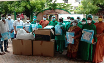 Handing PPE to Indian hospital group 350